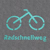 Logo Radschnellweg in grün auf Asphalt